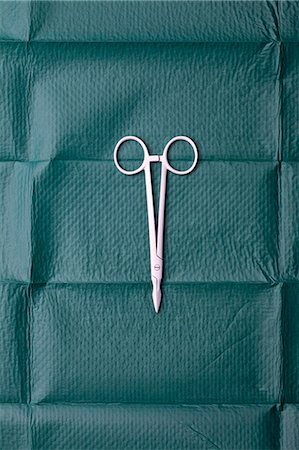 A pair of surgical scissors on a surgical drape Stock Photo - Premium Royalty-Free, Code: 653-06533836