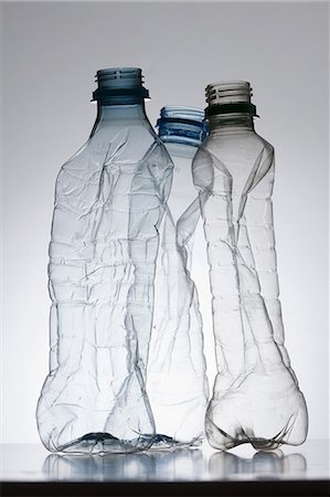 Three empty, partially crushed plastic water bottles Stock Photo - Premium Royalty-Free, Code: 653-06533831