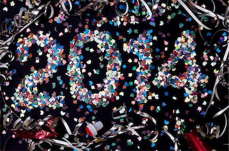 The year 2014 spelled out with confetti and surrounded by streamers Stock Photo - Premium Royalty-Free, Code: 653-06533854