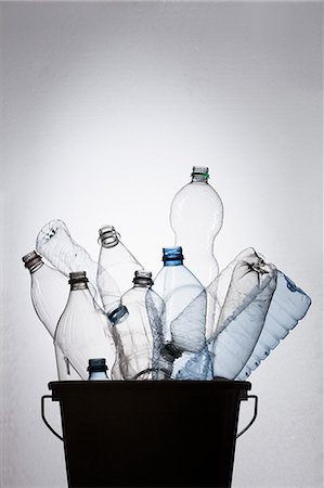 Bottles in bucket Stock Photo - Premium Royalty-Free, Code: 653-06533856