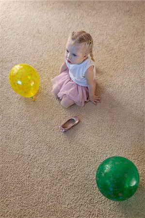 festive - Little girl between two balloons as her ballet shoe lies on the floor Stock Photo - Premium Royalty-Free, Code: 653-06819461