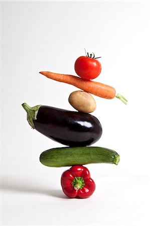 Vegetables arranged in a stack Stock Photo - Premium Royalty-Free, Code: 653-06819503