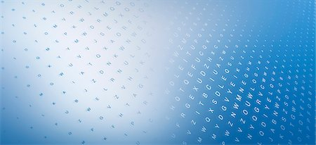 shimmering - Multiple rows of random letters on a blue surface Stock Photo - Premium Royalty-Free, Code: 653-06819574