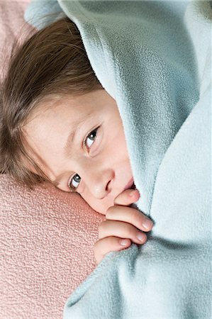 Girl under blanket Stock Photo - Premium Royalty-Free, Code: 653-06819659