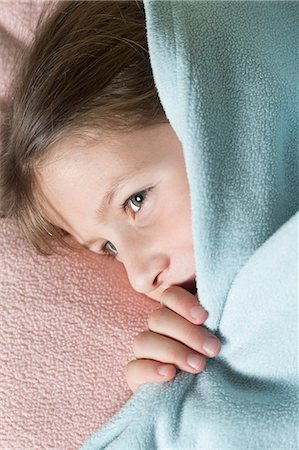 Girl under blanket Stock Photo - Premium Royalty-Free, Code: 653-06819680
