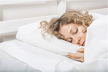 Woman sleeping n bed Stock Photo - Premium Royalty-Free, Code: 653-06819695