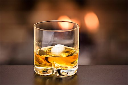 Glass of whiskey and ice Stock Photo - Premium Royalty-Free, Code: 653-06819703