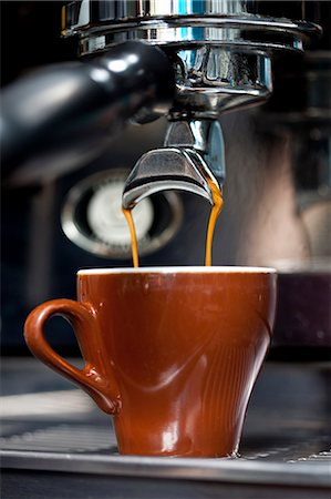 A double shot of espresso being poured from an espresso maker Stock Photo - Premium Royalty-Free, Code: 653-06819947