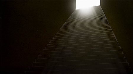 Stairs leading up to a brightly illuminated doorway Stock Photo - Premium Royalty-Free, Code: 653-07234075