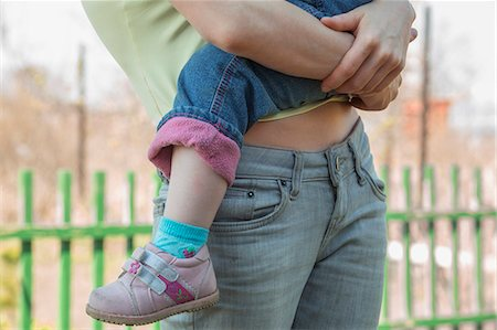 family shoes - Mother holding child Stock Photo - Premium Royalty-Free, Code: 653-07233753