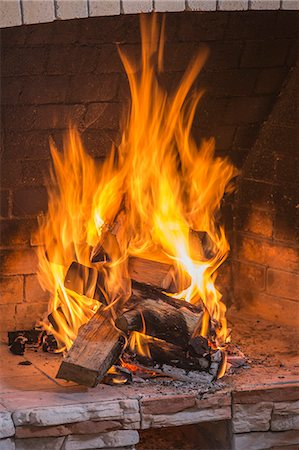 flame - A stack on fire wood ablaze in an open fire Stock Photo - Premium Royalty-Free, Code: 653-07233771