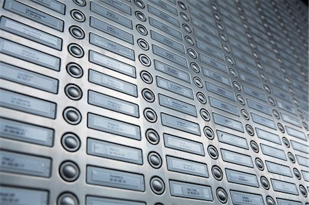repeating - Rows of doorbells on a metal panel Stock Photo - Premium Royalty-Free, Code: 653-07233796