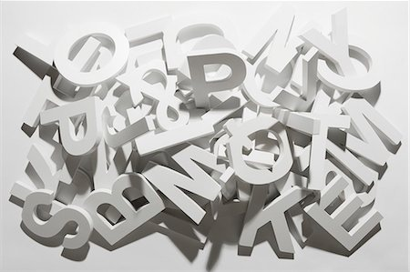 A pile of various white block letters from the alphabet Stock Photo - Premium Royalty-Free, Code: 653-07233798