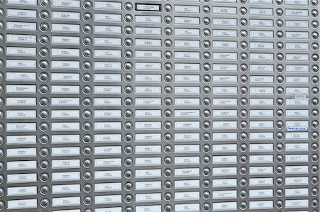 Rows of doorbells on a metal panel Stock Photo - Premium Royalty-Free, Code: 653-07233791