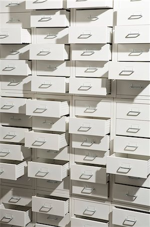 A white cabinet with drawers opened at varying degrees Stock Photo - Premium Royalty-Free, Code: 653-07233806