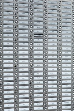 repeating - Rows of doorbells on a metal panel Stock Photo - Premium Royalty-Free, Code: 653-07233812