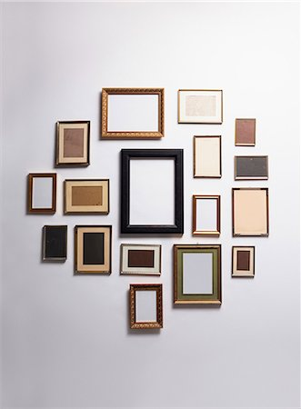 rectangle - Various empty picture frames hanging on a wall Stock Photo - Premium Royalty-Free, Code: 653-07233835