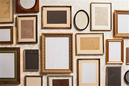 Various empty picture frames, close-up Stock Photo - Premium Royalty-Free, Code: 653-07233845