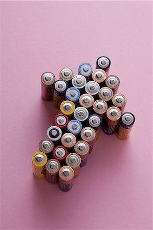 A large group of batteries arranged into the shape of an arrow, pointing up Stock Photo - Premium Royalty-Free, Code: 653-07233840