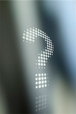 Dot patterned question mark against a background of shadow and light Stock Photo - Premium Royalty-Free, Code: 653-07233910