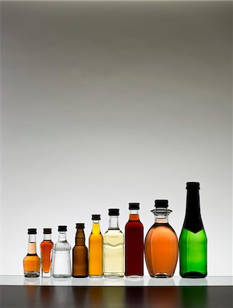 A line of various miniature bottles of alcohol without labels, back lit Stock Photo - Premium Royalty-Free, Code: 653-07233968