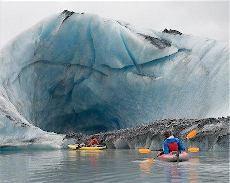 Kayaking beside ice cave at Valdez Glacier, Alaska, USA Stock Photo - Premium Royalty-Free, Code: 653-07233981