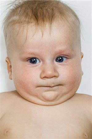 A baby boy grimacing, close-up Stock Photo - Premium Royalty-Free, Code: 653-07233994