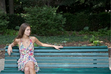 people sitting on bench - Young woman sitting on park bench Stock Photo - Premium Royalty-Free, Code: 653-07539011