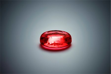 A piece of red hard candy Stock Photo - Premium Royalty-Free, Code: 653-07761294