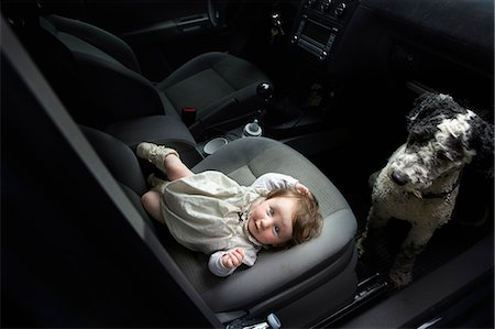 Baby girl and Portuguese Water Dog in car Stock Photo - Premium Royalty-Free, Code: 653-07761356