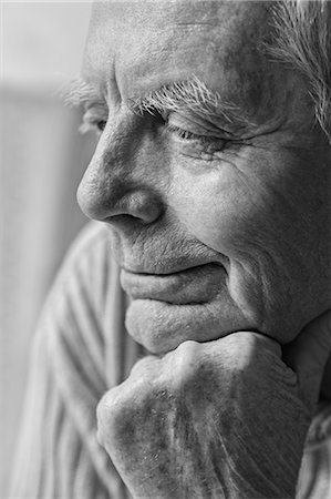 Thoughtful senior man with hand on chin looking away Stock Photo - Premium Royalty-Free, Code: 653-07761401