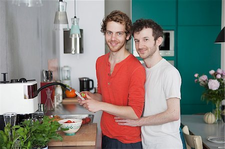 Portrait of loving gay couple in kitchen Stock Photo - Premium Royalty-Free, Code: 653-07761479