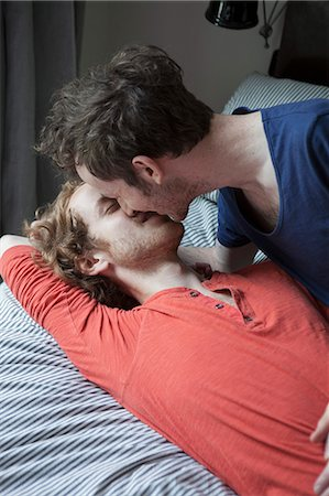 Young gay couple kissing in bedroom Stock Photo - Premium Royalty-Free, Code: 653-07761484
