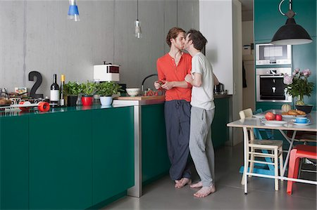 Full length of romantic gay couple kissing in kitchen Stock Photo - Premium Royalty-Free, Code: 653-07761491