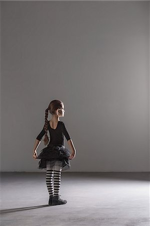 pantyhose kid - Full length rear view of girl in ballet costume in studio Stock Photo - Premium Royalty-Free, Code: 653-08126184