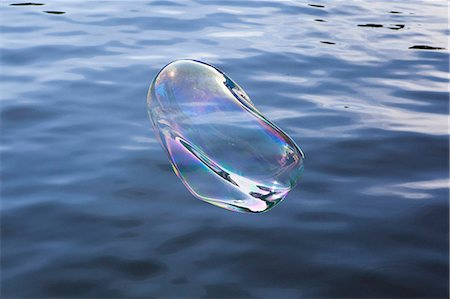 fragile - High angle view of bubble over water Stock Photo - Premium Royalty-Free, Code: 653-08172001