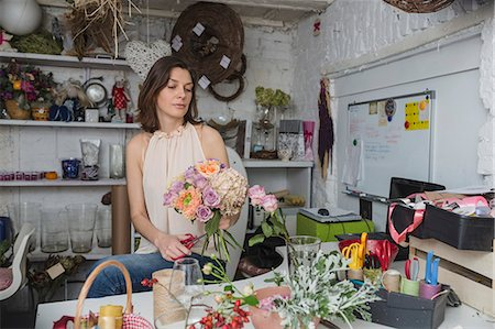 Female owner making flower bouquet at store Stock Photo - Premium Royalty-Free, Code: 653-08276577