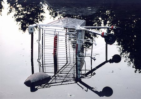 empty shopping cart - Shopping cart in pool of water Stock Photo - Premium Royalty-Free, Code: 653-01654454