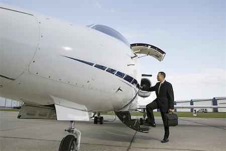 Businessman boarding a private airplane Stock Photo - Premium Royalty-Free, Code: 653-01654666
