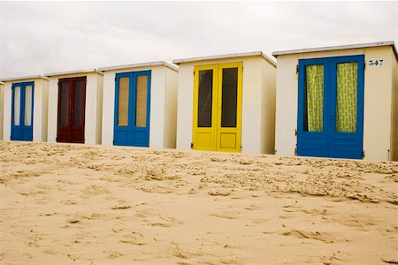 Beach huts on sand in a row Stock Photo - Premium Royalty-Free, Code: 653-01656732