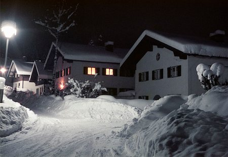 Snow covered cabins at night Stock Photo - Premium Royalty-Free, Code: 653-01657478