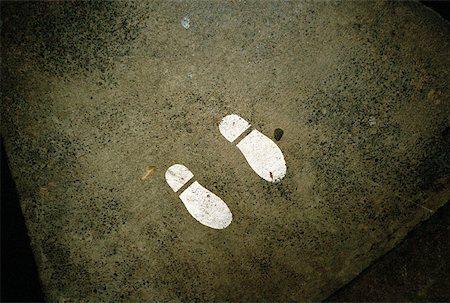 stenciling - Shoe print on street corner Stock Photo - Premium Royalty-Free, Code: 653-01659855