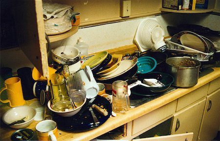 dirty dishes piled in a sink Stock Photo - Premium Royalty-Free, Code: 653-01650834