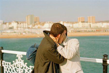Two men kissing Stock Photo - Premium Royalty-Free, Code: 653-01652506