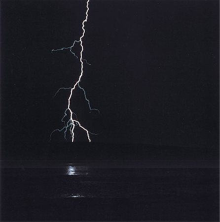 elements (weather) - Lightning over water at night, New Mexico, USA Stock Photo - Premium Royalty-Free, Code: 653-01653127