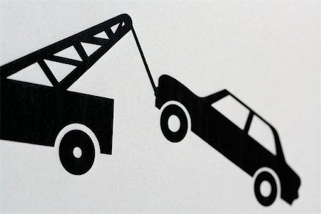 Information sign showing car being towed Stock Photo - Premium Royalty-Free, Code: 653-01664354