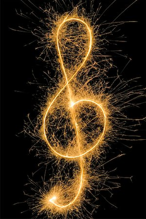 Treble Clef drawn with a sparkler Stock Photo - Premium Royalty-Free, Code: 653-01665226