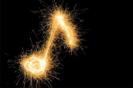 pic music note symbol - Musical note drawn with a sparkler Stock Photo - Premium Royalty-Free, Code: 653-01665255