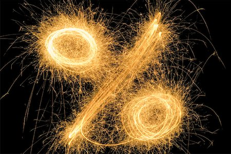 percentage symbol - Percentage sign drawn with a sparkler Stock Photo - Premium Royalty-Free, Code: 653-01665252