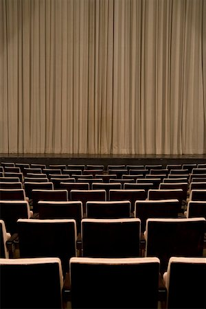 Closed curtain in an empty theater Stock Photo - Premium Royalty-Free, Code: 653-01665888
